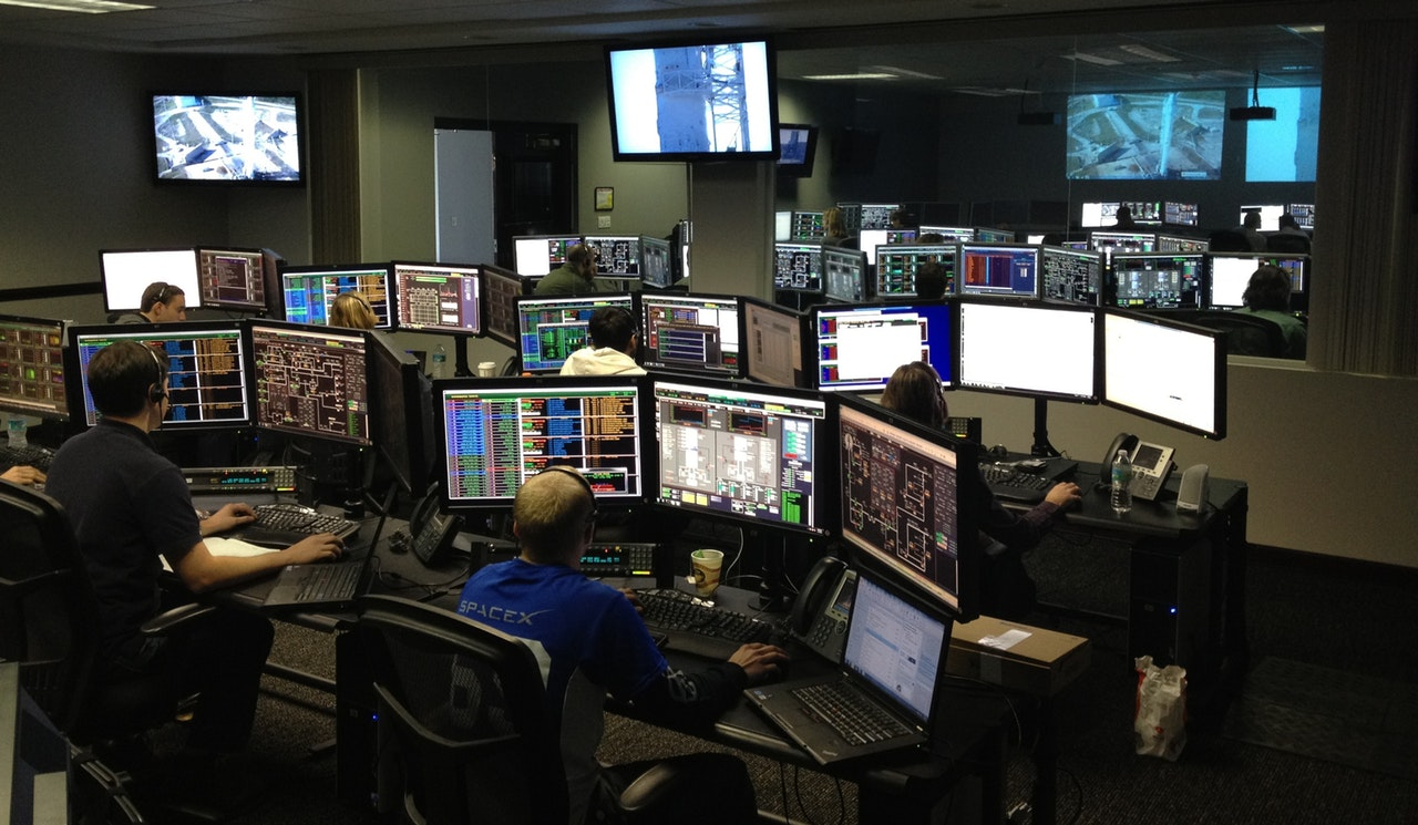 People working at night in a computer watch floor.